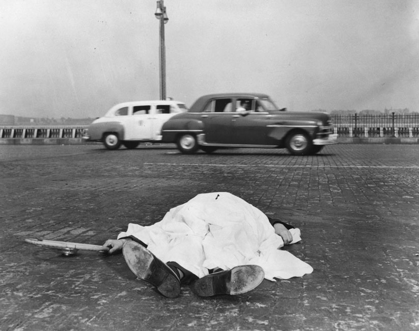 The Victim of a Motor Accident Lies by the Side of the West Side Highway in New York, Covered by a Sheet