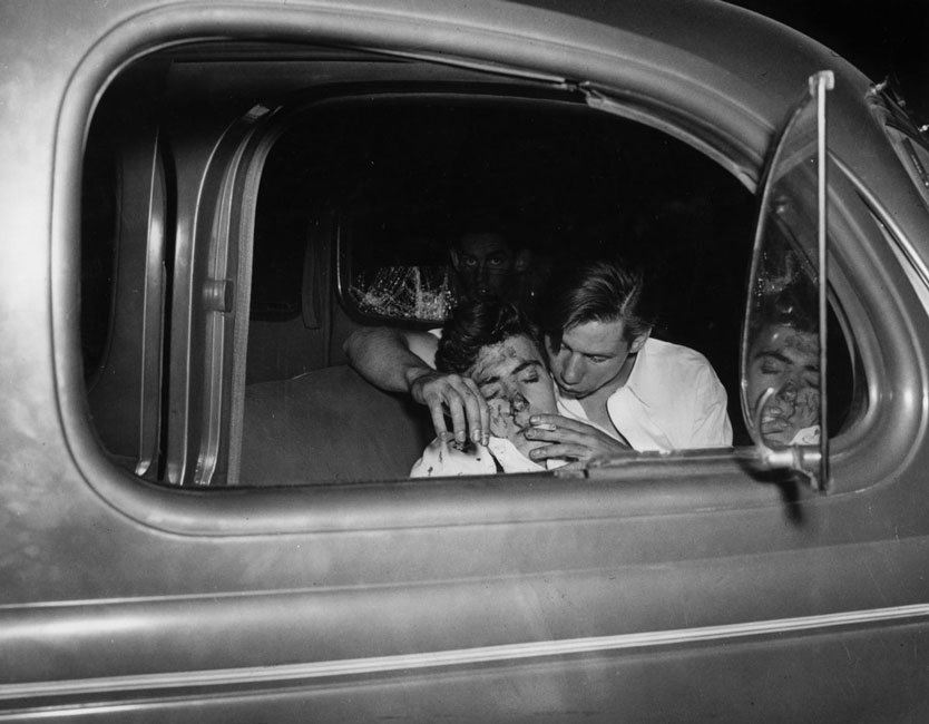 Weegee: Young Man Smoking a Cigarette After a Car Crash