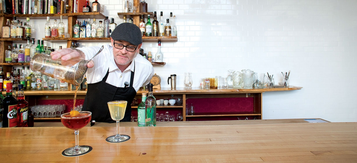 Mixologist Sean Enright crafts signature drinks from local spirits at Livermore in East Liberty. He pours a Red Wedding cocktail, which contains Wigle Whiskey's Giaever (a genever-style gin made in the Strip District), Aperol, Cynar and orange peel. The other drink is a Glenshaw 75 (a twist on a French 75), which was made with Boyd & Blair Vodka (distilled in Shaler), dry vermouth, prosecco, orange bitters and lemon peel.