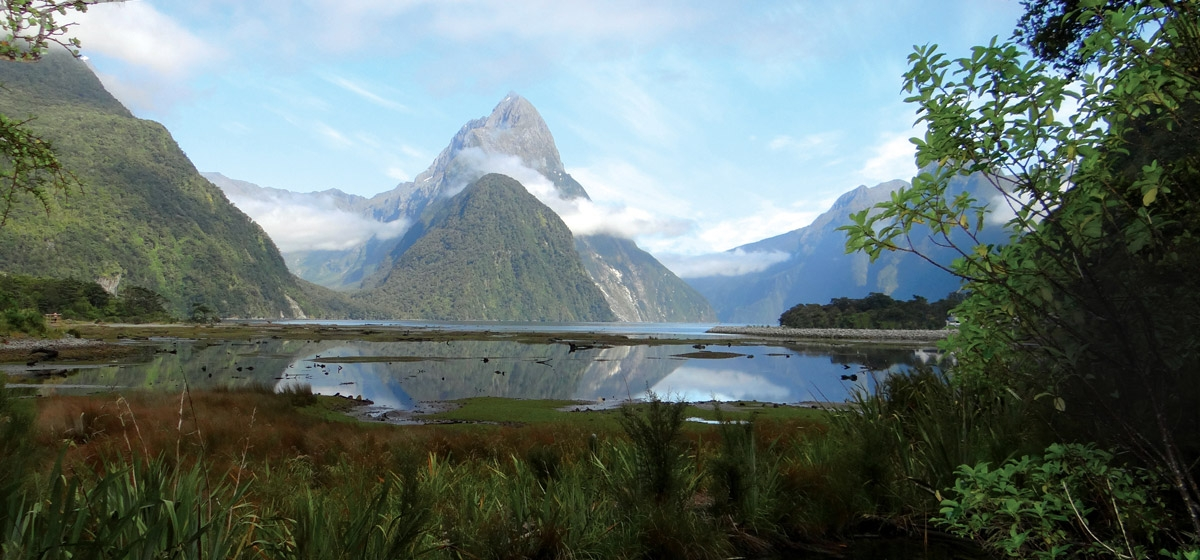 The end of the earth  //  Mitre Peak towers over what's been judged the world's top travel  destination—Milford Sound, Fiordland National Park, South Island, New Zealand.
