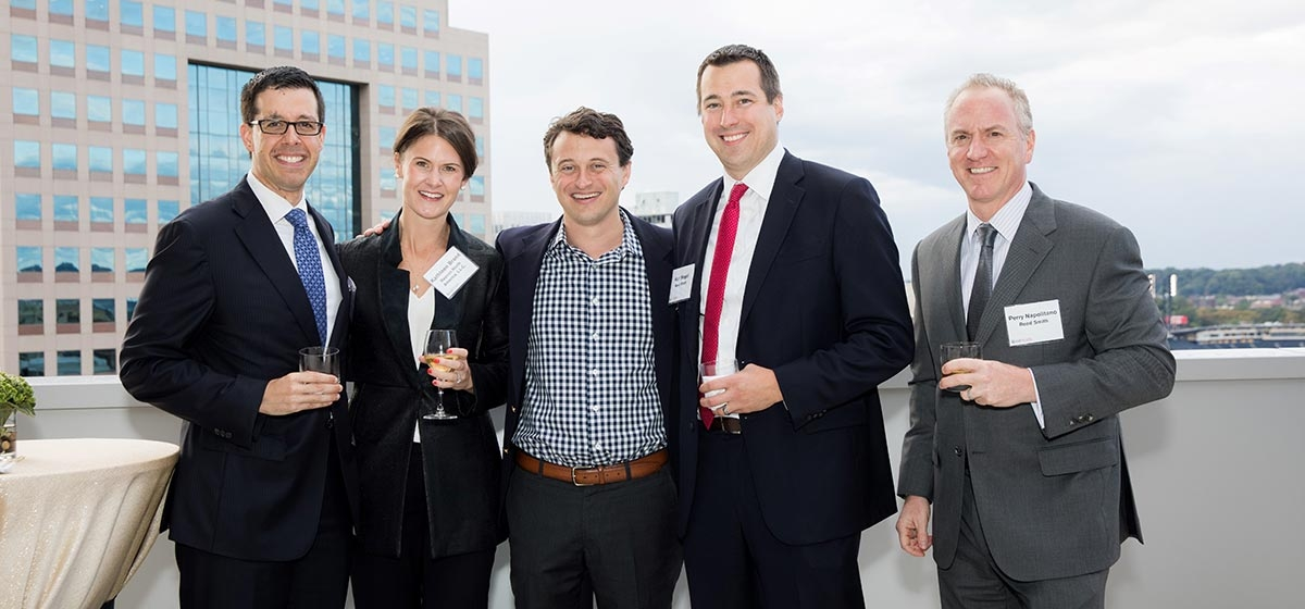 Reed Smith Partner James Rockney joined guests from Reecon North America, Kathleen Brand and David Brand, and Reed Smith Associate Ken Siegel and Partner Perry Napolitano on the firm's outdoor terrace. Reed Smith's 140th Anniversary Reception. September 7, 2017.