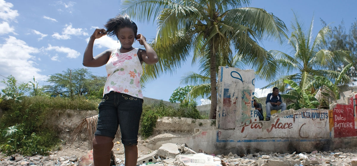 Natasha Millen, 25, amid the rubble that pinned her leg during the January earthquake near her home in Port au Prince. Millen's leg was amputated and she recently received a prosthetic leg and rehabilitation at the Hanger Clinic at Hôpital Albert Schweitzer.