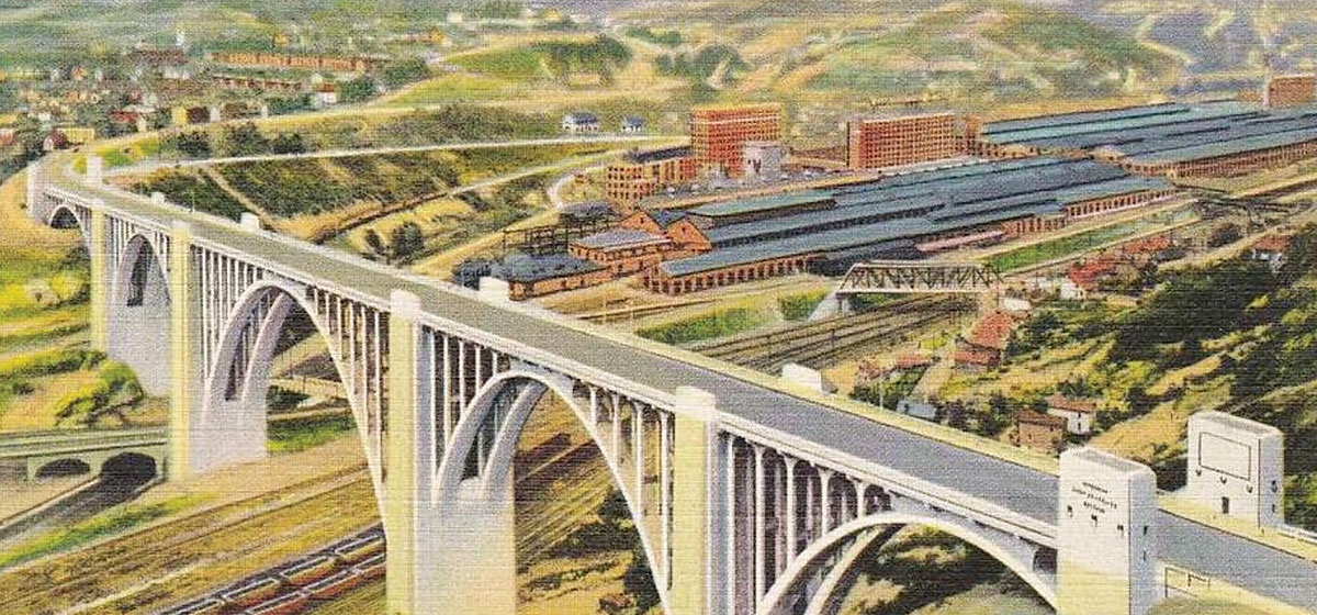 This postcard shows the streamlined arches of the George Westinghouse Bridge gracefully spanning the Turtle Creek Valley above a tangle of railway lines and the sprawl of a dominant Westinghouse plant.