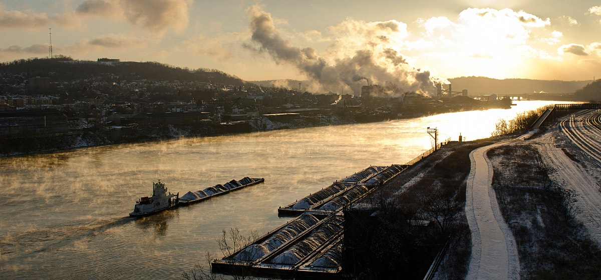 Waterway at work // January 8: With the temperature near zero degrees, barges transport coal on the Monongahela River near the Rankin Bridge at dawn. The Edgar Thomson Steel Works in Braddock is in the distance.