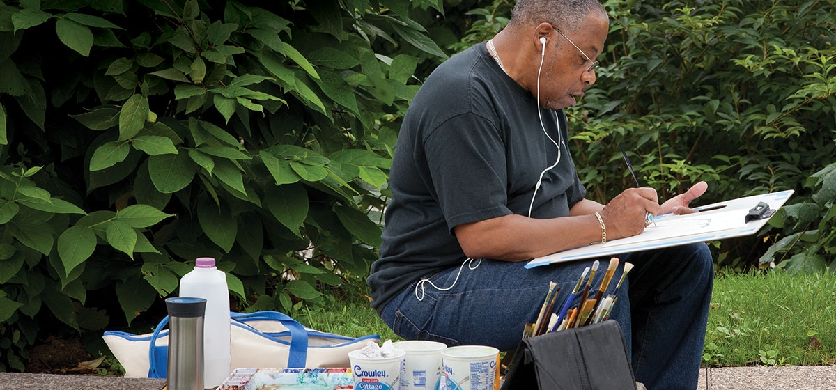 Terrell Jefferson paints a scene at Phipps Conservatory under the tutelage of Osher instructor Elaine Bergstrom, whose classes often fill up on the first day of registration.