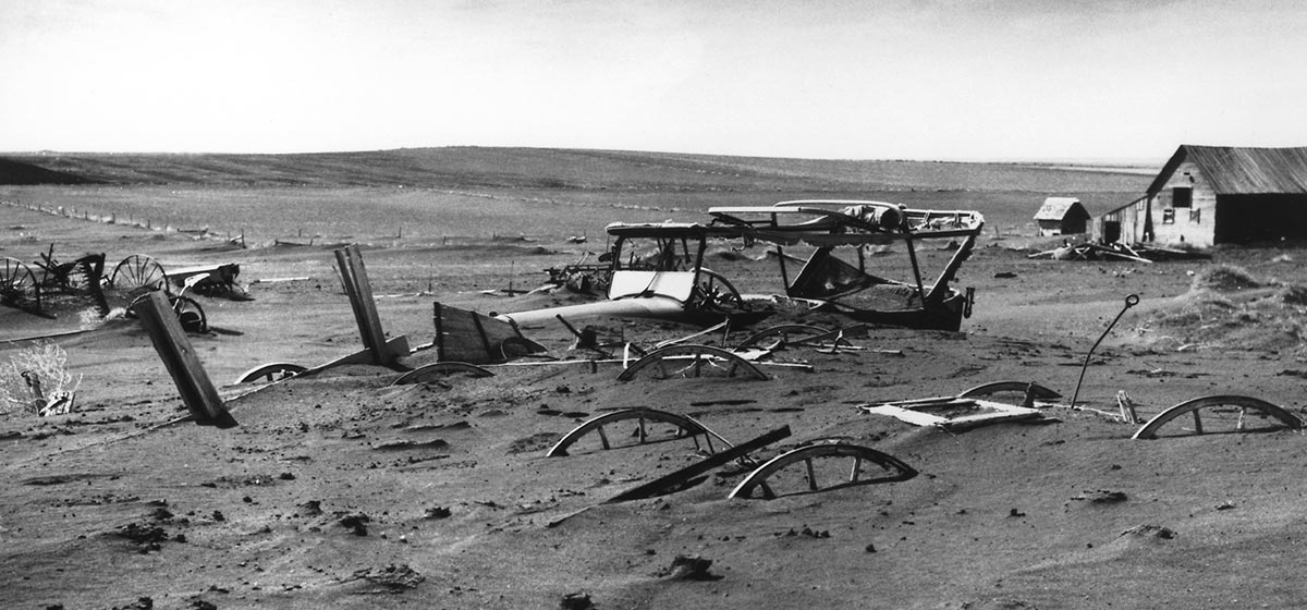 Buried machinery in barn lot in Dallas, South Dakota during the Dust Bowl, an agricultural, ecological, and economic disaster in the Great Plains region of North America in 1936.
