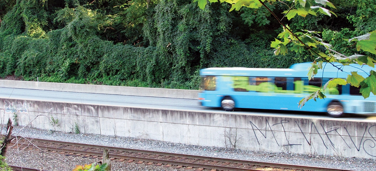 During the evening rush hour, an east-bound bus glides along the Martin Luther King Jr. East Busway as viewed from under the Millvale Avenue Bridge in Bloomfield. Pittsburgh's dedicated bus-only highway has been in operation since 1983.