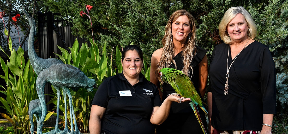 Cathy Schlott, Curator of Behavioral Management and Training, National Aviary, with Mac the Military Macaw; Event Chair Jennifer Bertetto, President and CEO, Trib Total Media; and Cheryl Tracy, Executive Director, National Aviary. National Aviary, Ladies Night Out. September 20, 2019.