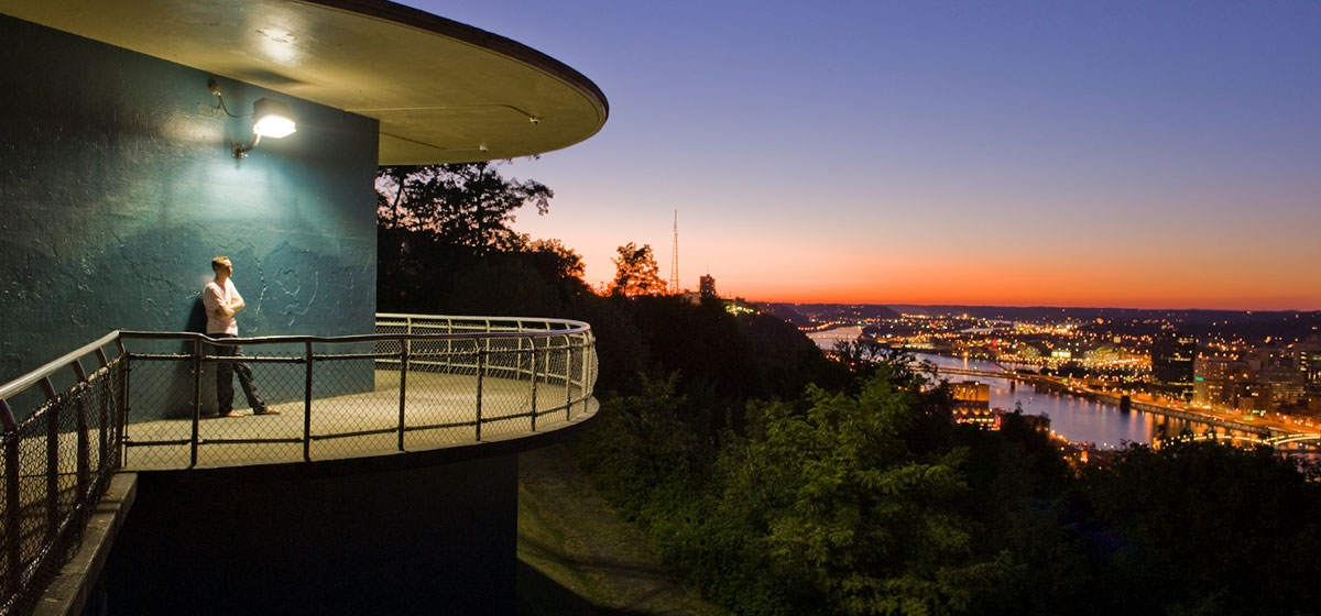 Grandview Park at dusk reveals a jewel-toned view of Pittsburgh.