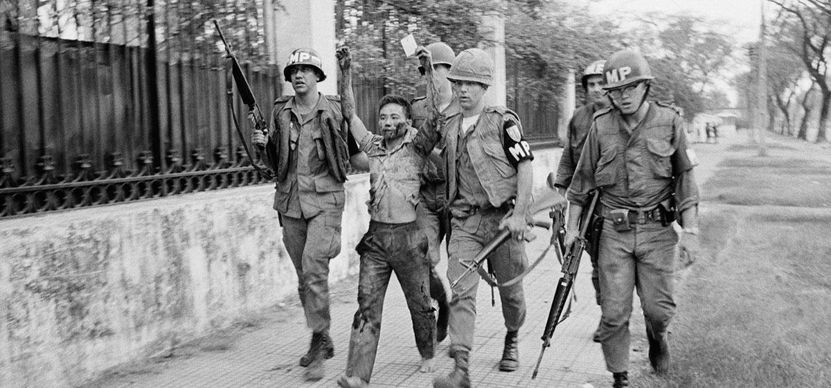 February 3, 1968. Saigon, South Vietnam. Military policemen capture a Vietcong guerrilla after a surprise attack on the United States embassy and South Vietnamese government buildings in Saigon on January 31, 1968.