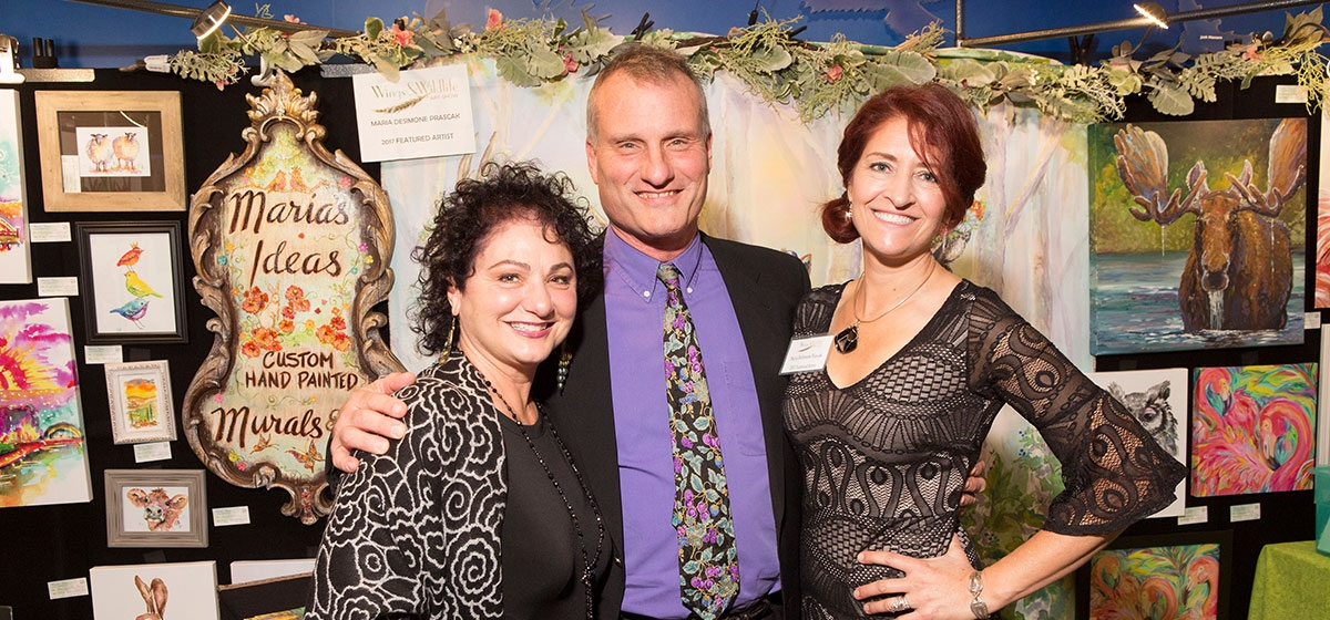 John and Valerie Nicklas with Featured Artist, Maria DeSimone Prascak. Wings & Wildlife Opening Soirée and Benefit Auction, the National Aviary. November 3, 2017.