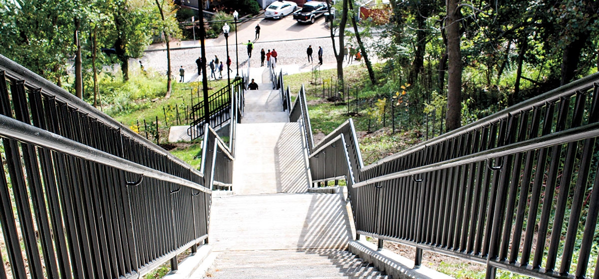 From behind Pitt's Frick Fine Arts Building, this recently rebuilt stairway steps down about 130 stairs to Joncaire Street. A runnel, a narrow groove for bike wheels, is on the lower left.