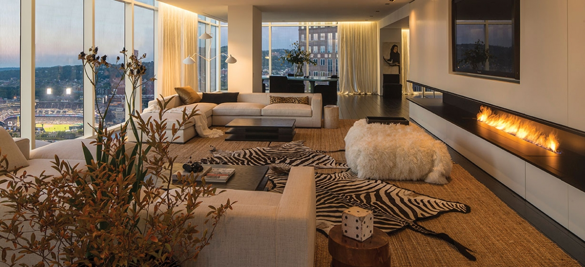 Designer Rachel Farley emphasized texture rather than pattern in the living room of this Downtown condo so as not to compete with the extraordinary views, including one of PNC Park. A steel channel is cut into the wall on three sides for the gas fireplaces, with hidden cabinetry above and below. The sofas are B&B Italia and the coffee tables were designed by Farley.