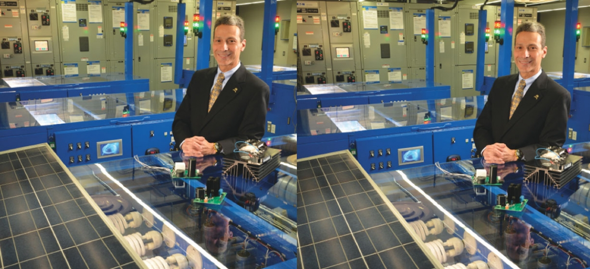 Professor Gregory Reed stands amid advanced AC-DC microgrid technologies in the Electric Power Systems Lab at the University of Pittsburgh's Swanson School of Engineering. Reed and his colleagues aim to make DC the energy transmission method of the future.