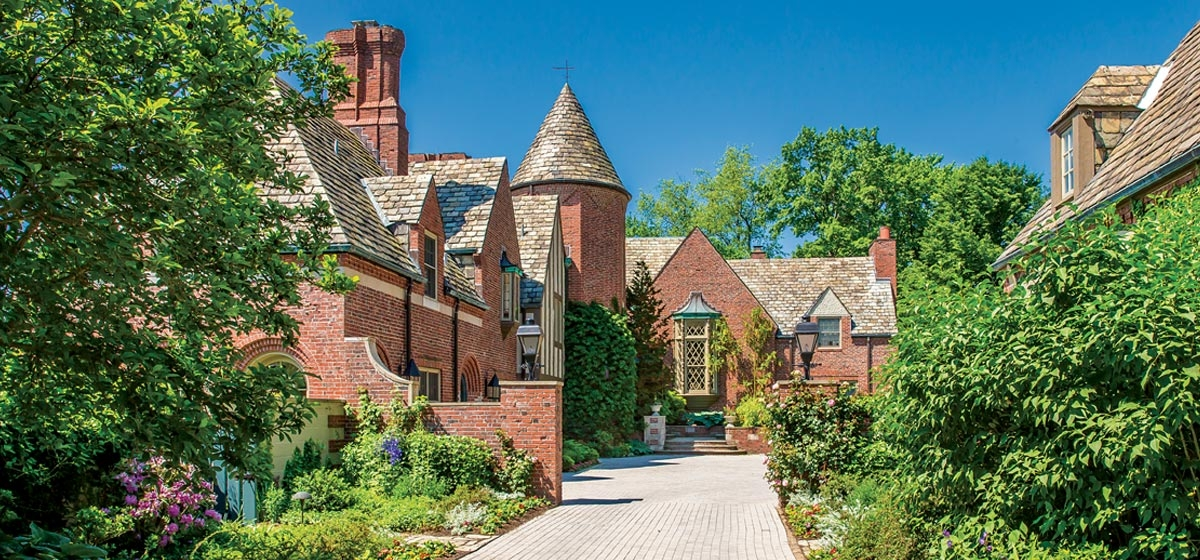 Designed by Brandon Smith and built in 1928, this Fox Chapel Tudor Revival commands sweeping views from its hilltop perch and offers Old World charm, including a walled entrance courtyard and numerous gardens.