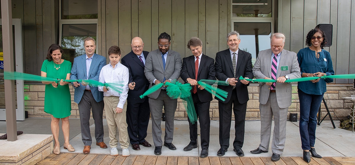 Cathy Fitzgerald, Steven Massaro, Joseph Massaro, Karl Steinmetz, Majestic Lane, Richard Piacentini, Jeff Davis, Ryan Martin and Erica Cochran perform the ribbon cutting, officially debuting the Exhibit Staging Center. Phipps' Big Green Block Party. May 16, 2019.