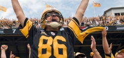 Wearing a vintage football helmet, Mike Panza celebrates a Steelers touchdown against Houston at Heinz Field. Panza lives in Jefferson Hills and has been a Steelers season ticket holder for 25 years.