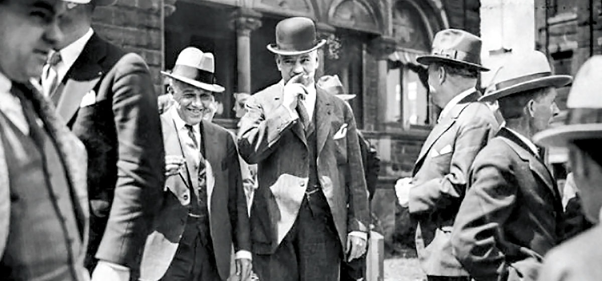 Mayor Charles Kline smokes a cigarette during a break in his trial for malfeasance in office. Kline was the most corrupt official in the history of Pittsburgh. From the Pittsburgh Post-Gazette Archives.