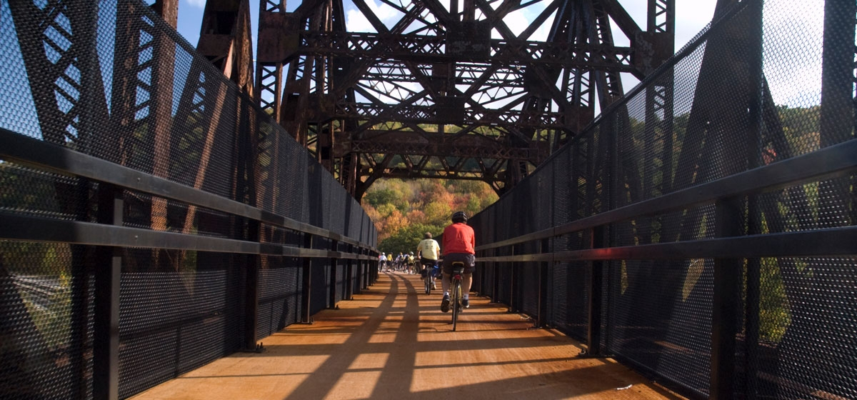 Cyclists on the 909-foot Keystone Viaduct in Somerset County at mile 30 of the Great Allegheny Passage.