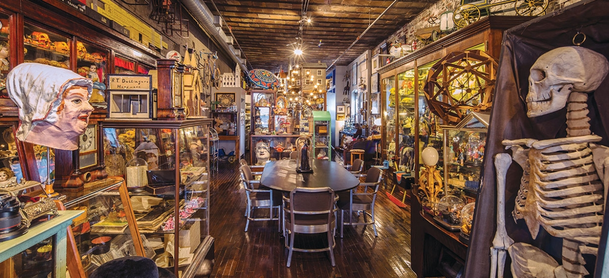 Barbara Luderowski's eclectic and extensive acquisitions are displayed in vintage cabinets that line the walls of the condo situated atop the Mattress Factory art museum. A Masonic papier-mâché skeleton and a German papier-mâché head from the 1880s are among the curiosities.