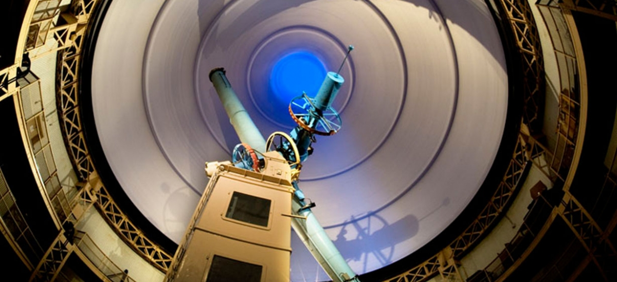A dramatic view of the Thaw Memorial Refractor from inside the observatory's largest dome. This image was made with a five-minute exposure of the top of the dome rotating.