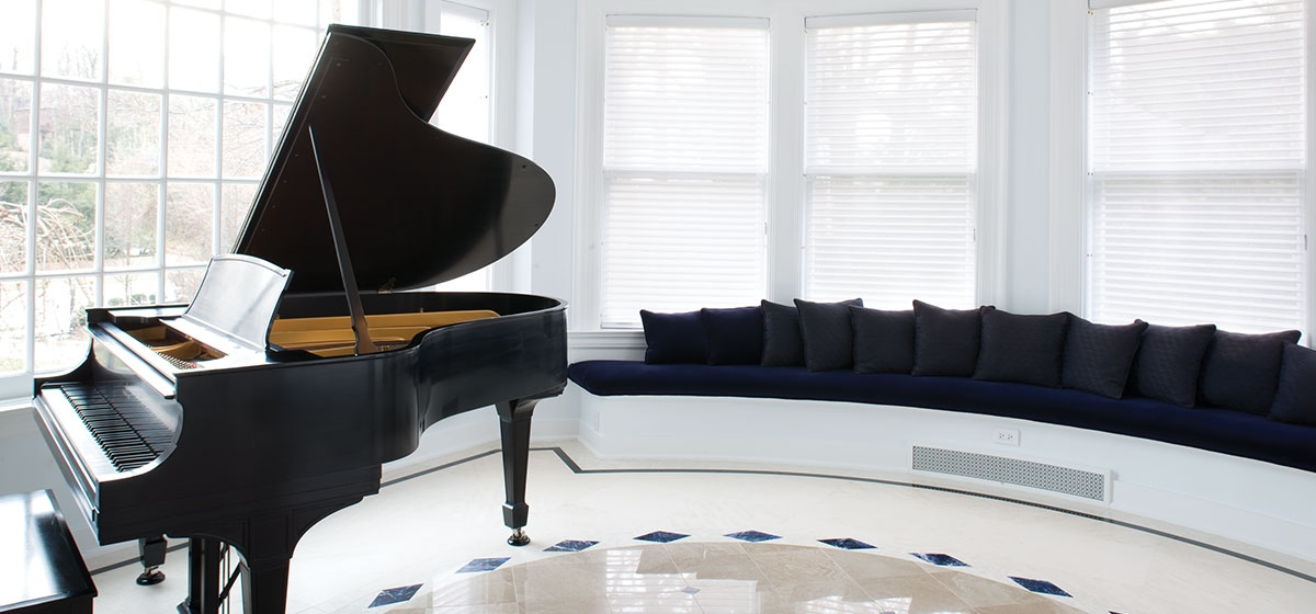 A 1917 Steinway grand piano commands the conservatory, which features a Portugese limestone floor inlaid with lapis and China black marble. Incandescent light spills from the PH Artichoke steel fixture designed by Poul Henningsen.