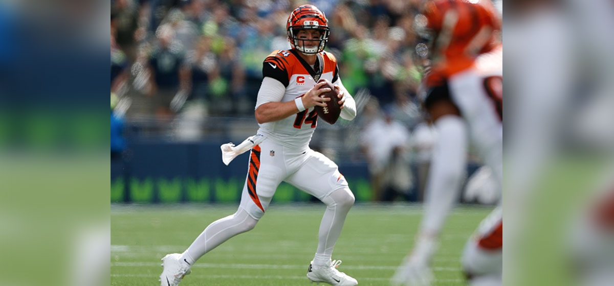 SEATTLE, WA - SEPTEMBER 08: Quarterback Andy Dalton #14 of the Cincinnati Bengals looks downfield to pass against the Seattle Seahawks at CenturyLink Field on September 8, 2019 in Seattle, Washington.