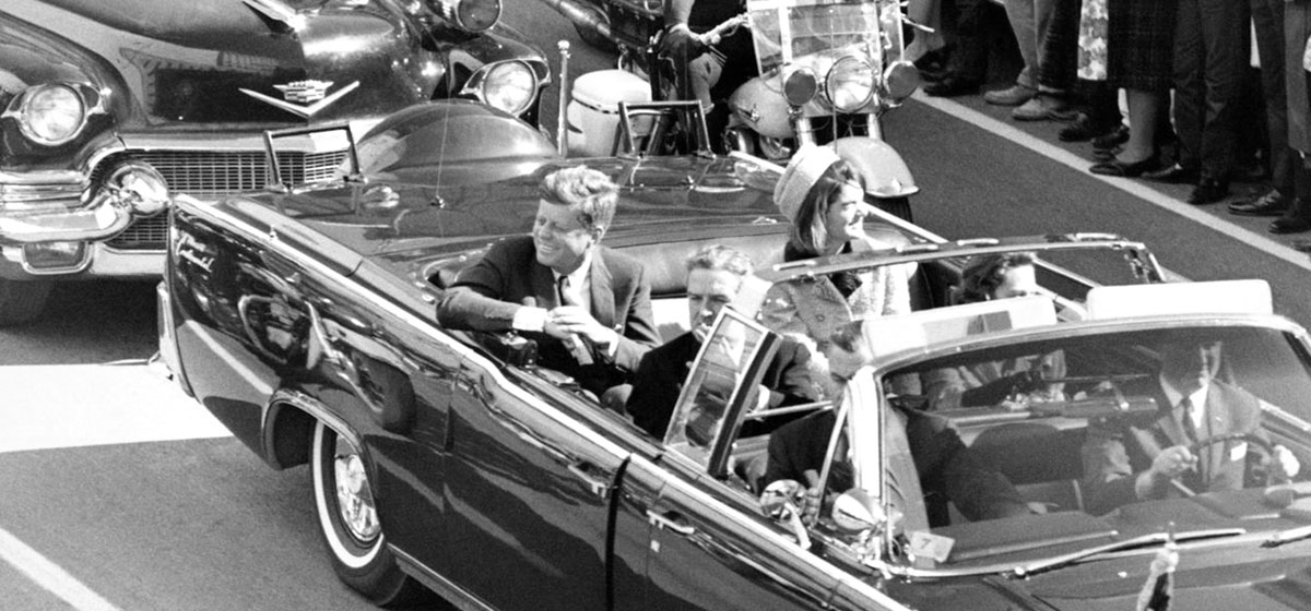 President Kennedy in the limousine in Dallas, Texas, on Main Street, minutes before the assassination on Nov. 22, 1963. Also in the presidential limousine are Jackie Kennedy, Texas Governor John Connally, and his wife, Nellie.