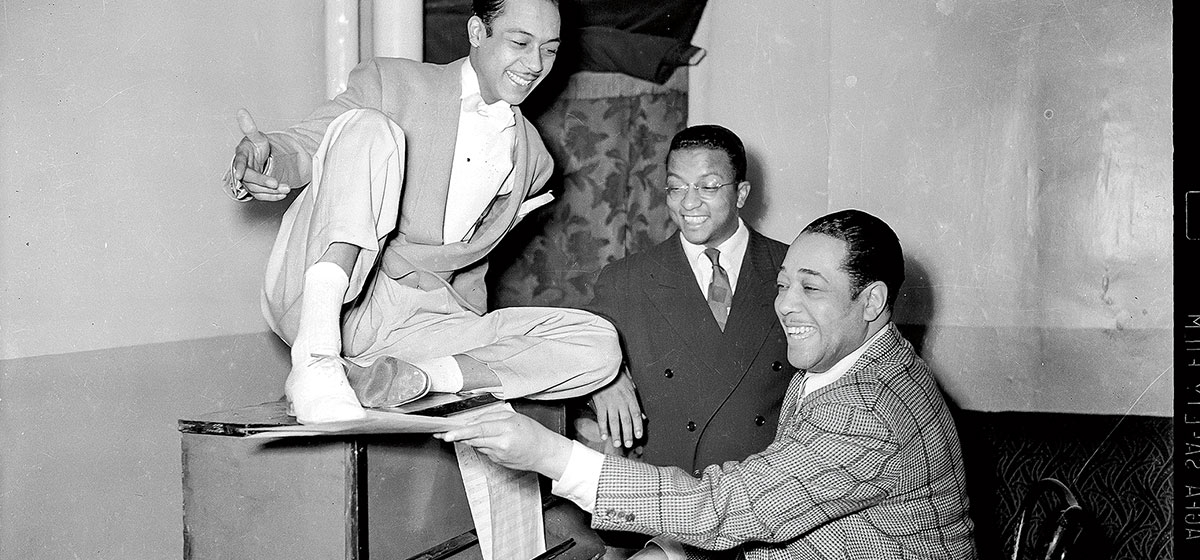 "Duke Ellington (right), Billy Strayhorn (center) and dancer Charles ""Honi"" Coles at the Stanley Theatre, the show palace where Ellington and Strayhorn first met."