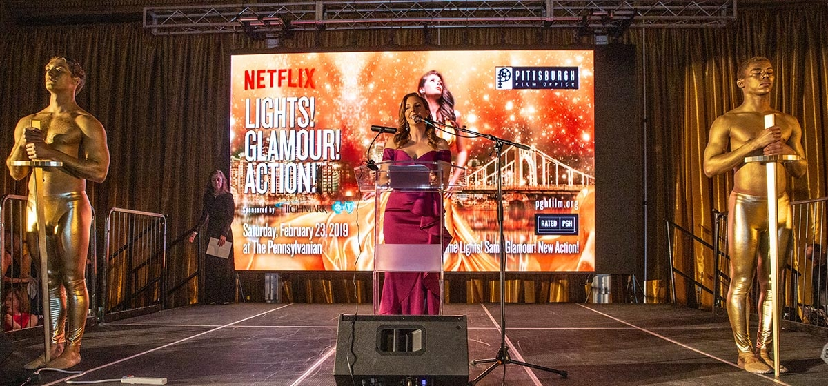 Emcee Ashley Dougherty from WTAE-TV (ABC) addressing the crowd of 750. Pittsburgh Film Office, Lights! Glamour! Action! February 23, 2019. The Pennsylvanian.