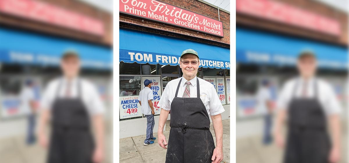 Tom Friday, in front of his Brighton Heights market, is known for quality meats
