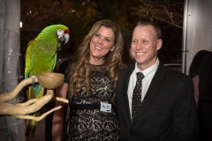 Jennifer-Bertetto-Trib-Total-Media-President-and-CEO-and-National-Aviary-Board-Member-and-Keith-Bertetto-with-Mac-the-Military-Macaw_photo-by-Rick-Armstrong