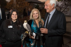 Thea-Martin-Principal-at-Desmone-Architects-and-National-Aviary-Board-Member-and-Mark-Houmis-with-Cathy-Schlott-National-Aviary-and-Lanner-Falcon